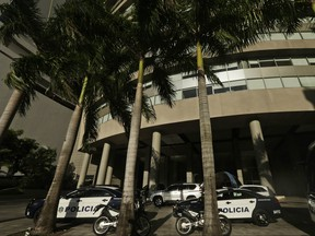 Police cars park outside the main entrance to the Trump Ocean Club International Hotel and Tower, in Panama City, Wednesday, Feb. 28, 2018. (AP Photo/Arnulfo Franco)