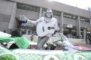 Silver Elvis street muse and musician at the Toronto St Patrick's Day parade on Sunday March 11, 2018. Jack Boland/Toronto Sun/Postmedia Network