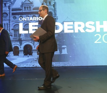 Hartley Lefton,  chair of the Leadership Organizing Committee, leaves the stage after telling supporters to go home as votes were still being assessed  at the Ontario PC leadership convention on Saturday March 10, 2018. Jack Boland/Toronto Sun/Postmedia Network