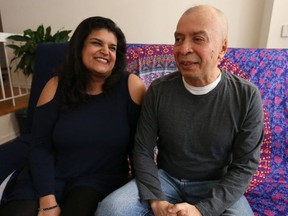 """Noora Sagarwala (L) sits with Francisco Molina who almost died on the College Street subway platform on Feb. 12 after being randomly targeted by a man who rammed an ice pick up through his nose hitting his left optic nerve and piercing his brain. A Go Fund me page has been set up by his """"angel"""" Sagarwala to help him with medical expenses  on Wednesday March 14, 2018. (Jack Boland/Toronto Sun/Postmedia Network)"""