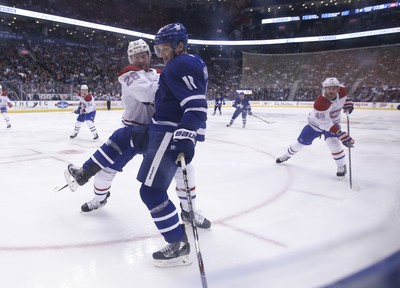 Montreal Canadiens Mike Reilly D (28) pushes off Toronto Maple Leafs Zach Hyman C (11) during the first period in Toronto on Saturday March 17, 2018. Jack Boland/Toronto Sun/Postmedia Network