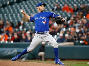 Toronto Blue Jays starting pitcher Marco Estrada throws to the Baltimore Orioles in the first inning of a baseball game, Wednesday, April 11, 2018, in Baltimore. (AP Photo/Patrick Semansky)