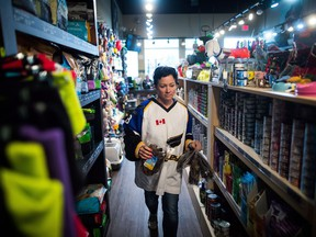 Jennifer Pinch, who organized Jersey Day, which encourages people to wear a sports jersey, hockey or otherwise on Thursday in support of the Humboldt Broncos hockey team, works in the pet supply she owns in Langley, B.C., on Wednesday April 11, 2018.