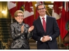 Former Ontario Premiere Dalton McGuinty laughs with Ontario Premier Kathleen Wynne before McGuinty's official portrait is unveiled at Queen's Park in Toronto Tuesday February 23, 2016. THE CANADIAN PRESS/Mark Blinch