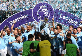 Manchester City celebrates with the Premier League trophy. (GETTY IMAGES)
