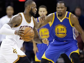 In this June 9, 2017 file photo, Cleveland Cavaliers forward LeBron James  drives on Golden State Warriors forward Kevin Durant during the second half of Game 4 of basketball's NBA Finals in Cleveland