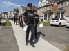 Peel Regional Police canvass the neighbourhood following a bombing from the previous night at the nearby Bombay Bhel restaurant in Mississauga, Ont. on Friday May 25, 2018. Ernest Doroszuk/Toronto Sun/Postmedia