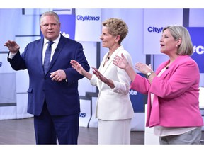 Liberal Premier Kathleen Wynne, centre, Progressive Conservative Leader Doug Ford, left, and NDP Leader Andrea Horwath take part in the Ontario Leaders debate in Toronto on Monday, May 7, 2018. This is the first of three debates scheduled before the June 7 vote.