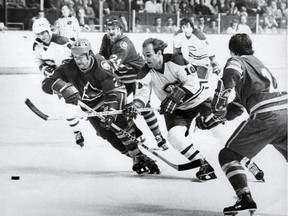 Guy Lafleur, who won five Stanley Cups with the Canadiens, tries to split the defence during game against the Colorado Rockies at the Montreal Forum. Lafleur scored at least 50 goals in six straight seasons with the Canadiens starting in 1974-75.