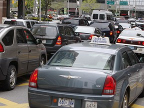 Traffic is gridlocked on southbound University Ave. (Toronto Sun files)