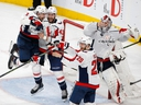 Members of the Washington Capitals celebrate as they defeat the Vegas Golden Knights in Game 5 of the NHL hockey Stanley Cup Finals to win the Stanley Cup on June 7, 2018