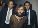 Charles Manson is escorted to his arraignment on conspiracy-murder charges in connection with the Sharon Tate murder case in 1969. (AP Photo)