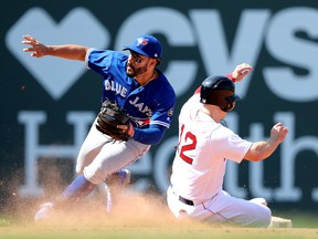 Brock Holt of the Boston Red Sox steals second past Devon Travis of the Toronto Blue Jays at Fenway Park on May 30, 2018 in Boston. (Maddie Meyer/Getty Images)