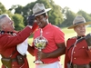 Jhonattan Vegas holds the winner's trophy as he tries on a Mountie stetson following his win at the final round of the 2017 Canadian Open at the Glen Abbey Golf Club in Oakville, Ont., on Sunday, July 30, 2017. THE CANADIAN PRESS/Nathan Denette ORG XMIT: NSD507