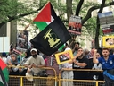 Demonstrator at Toronto's al-Quds Day rally at Queen's Park on Saturday wears the flag of the terror group Hezbollah.  B'nai Brith Canada