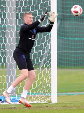 England's Jordan Pickford makes a save during a training session on Tuesday. (GETTY IMAGES)