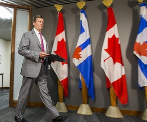 Toronto Mayor John Tory arrives to address media about community investments to combat gun and gang violence during a press conference at his office at city hall in Toronto, Ont. on Wednesday July 18, 2018. (Ernest Doroszuk/Toronto Sun)