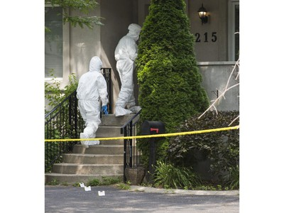 Halton Regional Police Forensic Identification officers at the scene of a homicide in the area of Rebecca St., east of Dorval Dr. in Oakville, Ont. on Saturday July 14, 2018. Ernest Doroszuk/Toronto Sun/Postmedia