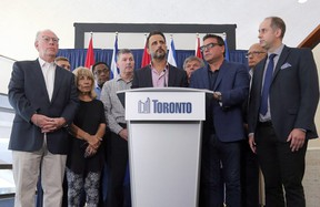 Councillor Justin Di Ciano, centre, and other Toronto councillors show solidarity to Premier Doug Ford's announcement to reduce city council to 25 wards in Toronto, Ont. on Friday July 27, 2018. Dave Abel/Toronto Sun