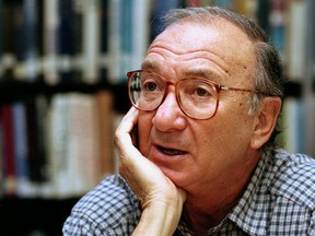 In this Sept. 22, 1994, file photo, American playwright Neil Simon answers questions during an interview in Seattle, Wash. (AP Photo/Gary Stuart, File)