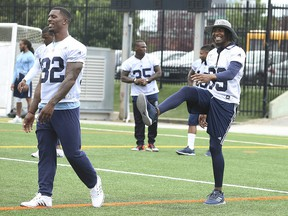 Toronto Argos wide receiver Duron Carter gets in some stretches at practice at Lamport Stadium with teammate James Wilder in Toronto on Wednesday, Aug. 29, 2018.