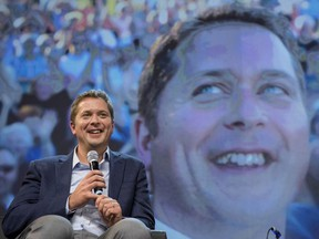 Conservative Leader Andrew Scheer is seen on stage while speaking to delegates at the Conservative national convention in Halifax on Saturday, August 25, 2018.
