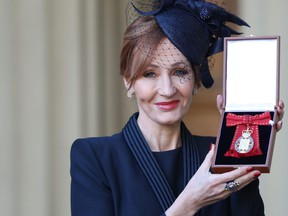 Harry Potter author J.K. Rowling is made a Companion of Honour by the Duke of Cambridge during an Investiture ceremony at Buckingham Palace.