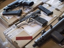 Police display guns seized during a series of raids at a press conference in Toronto on Friday, June 14, 2013. (THE CANADIAN PRESS/Chris Young)