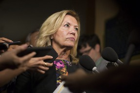 Ontario Deputy Premier Christine Elliott talks with journalists following Question Period at the Ontario Legislature in Toronto on Wednesday, August 1, 2018.THE CANADIAN PRESS/Chris Young