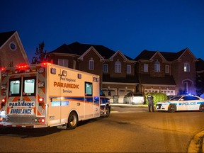 A woman and a boy were pronounced dead after being pulled from a pool. (JOHN HANLEY PHOTO)