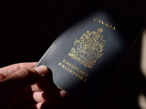 A Canadian passport is displayed in Ottawa on July 23, 2015. (The Canadian Press)