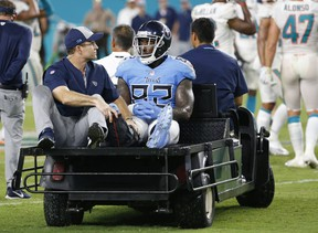 Tennessee Titans tight end Delanie Walker is driven off the field after he injured his leg last week. (AP PHOTO)