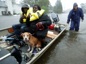 Volunteers from all over North Carolina help rescue residents and their pets from their flooded homes during Hurricane Florence Sept. 14, 2018 in New Bern, N.C.