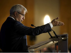 Ontario finance minister Vic Fedeli speaks during an Economic Club of Canada event in Toronto on Friday, Sept. 21, 2018.