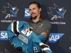 Newly acquired San Jose Sharks defenseman Erik Karlsson puts on jersey during a news conference held by the NHL hockey team in San Jose, Calif., Wednesday, Sept. 19, 2018. (AP Photo/Josie Lepe) ORG XMIT: SJA106