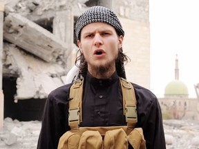 Dressed in the garb of the mujahideen, John Maguire is shown on six-minute video that contains a dire warning to Canadians and praises acts of Islamist extremism.