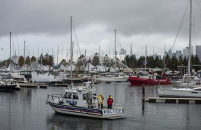 Crews battle a two-alarm boat fire at the Outer Harbour Marina early Sunday morning. (John Hanley photo)