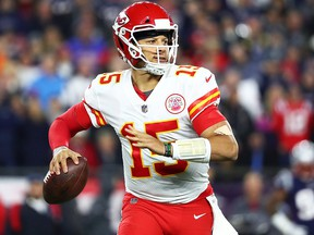 Patrick Mahomes  of the Kansas City Chiefs looks to pass in the second quarter of a game against the New England Patriots at Gillette Stadium on Oct. 14, 2018 in Foxborough, Mass.