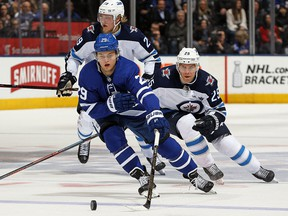 William Nylander of the Toronto Maple Leafs breaks past Paul Stastny of the Winnipeg Jets at the Air Canada Centre on March 31, 2018 in Toronto,. (Claus Andersen/Getty Images)