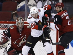 Ottawa Senators centre Jim O'Brien (40) tries to redirect the puck as Arizona Coyotes defenceman Oliver Ekman-Larsson (23) applies pressure and Antti Raanta, left, watches the puck Saturday, March 3, 2018, in Glendale, Ariz. (AP Photo/Ross D. Franklin)