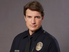 """Actor Nathan Fillion is shown in a promotional photo for the televion show """"The Rookie."""" (Bell Media)"""