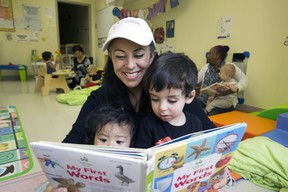 Sylvia Martignani, (with Carmelo and Timothy) at her daycare Angelic Treasures Christian Daycare. (Stan Behal/Toronto Sun)