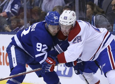 Toronto Maple Leafs Igor Ozhiganov D (92) goes cheek to cheek with Montreal Canadiens Mike Reilly D (28)during the second period in Toronto on Thursday October 4, 2018. Jack Boland/Toronto Sun/Postmedia Network