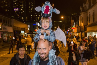 Tomi Sphere and his daughter Aleia,2, as Halloween comes to the Village as a part of Church St. is closed to traffic for Halloween on Church in Toronto, Ont. on Wednesday October 31, 2018. Ernest Doroszuk/Toronto Sun/Postmedia