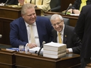 Premier Doug Ford, left, and Finance Minister Vic Fedeli in the legislature at Queen's Park. (Stan Behal/Toronto Sun)