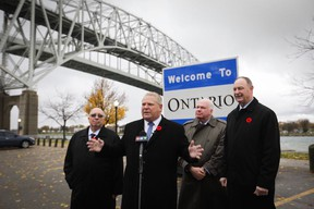 Premier Doug Ford, second from left, at the Bluewater Bridge in Sarnia on Nov. 2, 2018. (FordNation/Twitter)