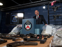 Toronto Police display handguns that had been hidden in a fuel tank and were seized as part of Project Belair.