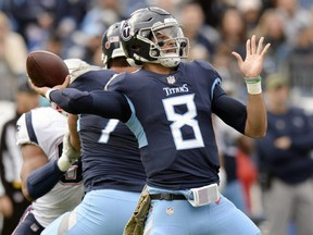 Titans quarterback Marcus Mariota throws a pass against the Patriots during NFL action in Nashville, Tenn., on Nov. 11, 2018. The Titans play the Texans, who have won seven games in a row, Monday night.