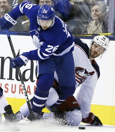 Toronto Maple Leafs center Par Lindholm (26 and Columbus Blue Jackets center Boone Jenner (38) battle for the puck during the first period on Monday November 19, 2018. The Toronto Maple Leafs host the Columbus Blue Jackets at the Scotiabank Arena in Toronto, On. Veronica Henri/Toronto Sun/Postmedia Network