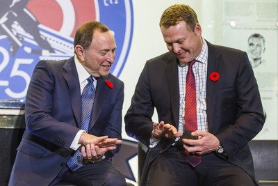 The 2018 Inductees into the Hockey Hall of Fame - Gary Bettman (left) and Martin Brodeur looks at their rings during a presentation at the Hockey Hall of Fame in Toronto, Ont. on Friday November 9, 2018.  Ernest Doroszuk/Toronto Sun/Postmedia
